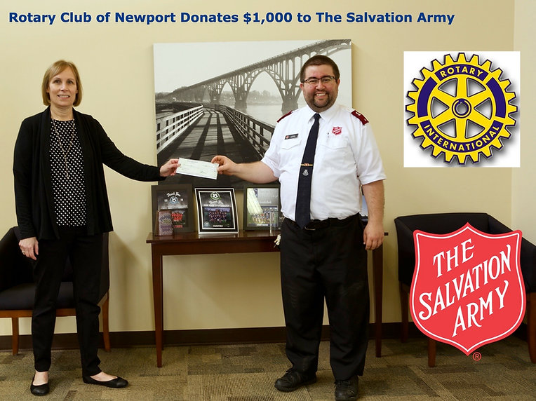Newport Rotary President Julie Hanrahan presents a check for $1,000 to Lieutenant Nathan Perry of the Salvation Army of Lincoln County.