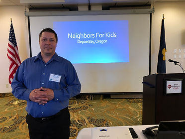 Toby Winn, Executive Director of Development at Neighbors for Kids speaks at the Rotary Club of Newport