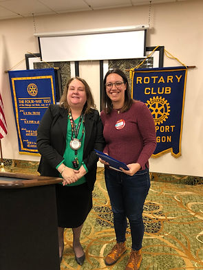 "At a Rotary of Newport meeting, Lola Jones accepts her ""Blue Badge"" from President Buckley."