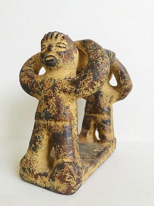 yellow incense figurine