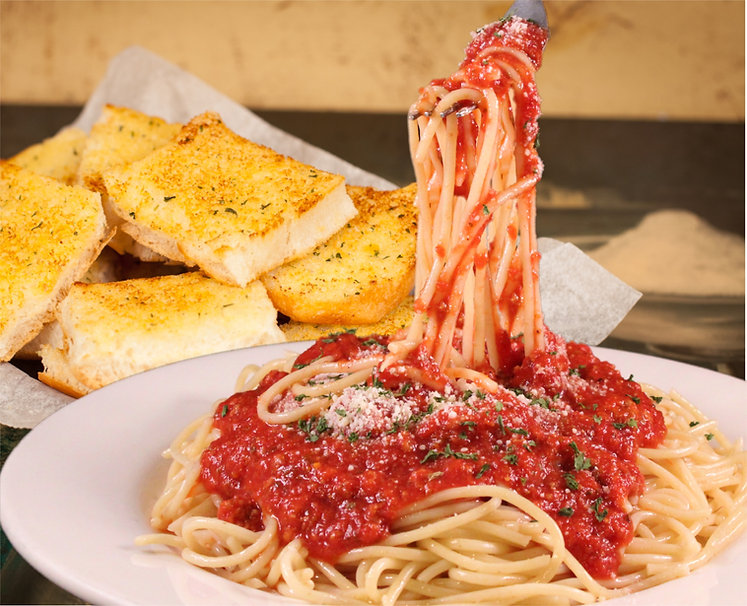 Zio Johno's famous Spaghetti with homemade meat sauce. Fresh garlic bread. The Hometown Taste of Italy.