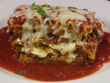 Lasagna Baked - Homemade Zio Johno's Lasagna. Amazing traditional meat or vegetarian lasagna baked fresh daily. Simply te Best!