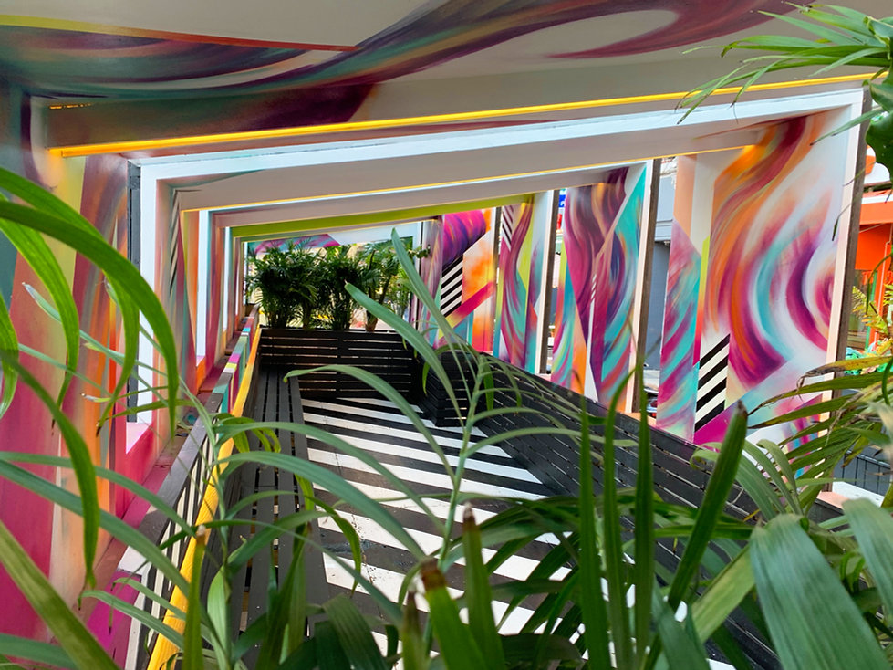 bianca romero art blend astoria custom outdoor seating area mural dj camilo