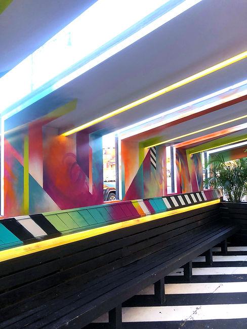 bianca romero blend astoria custom outdoor seating area mural