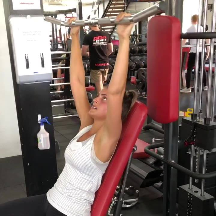 Try this back exercise. Wide grip pull downs whilst leaning back on an incline bench. This is a good way to isolate the back muscles being used.