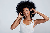 Beautiful african woman with afro listen