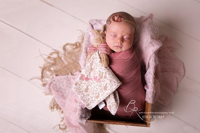 newborn-baby-girl-in-wooden-prop-photo-s