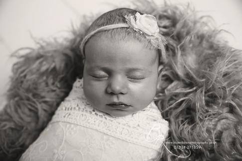 newborn-baby-girl-in-bowl-black-white-ph