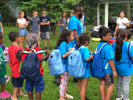 Local Teen Surprises 100 Students with Backpacks Filled with School Supplies
