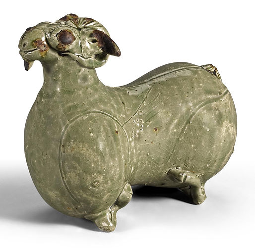A RARE 'YUE' FIGURE OF A RECUMBENT RAM