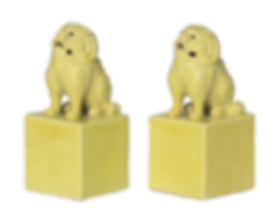 A PAIR OF YELLOW-GLAZED PORCELAIN SEALS