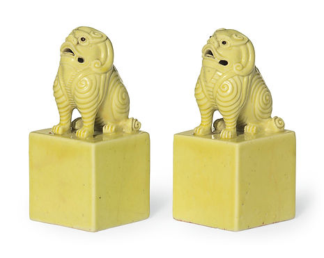 A PAIR OF YELLOW-GLAZED PORCEAIN SEALS