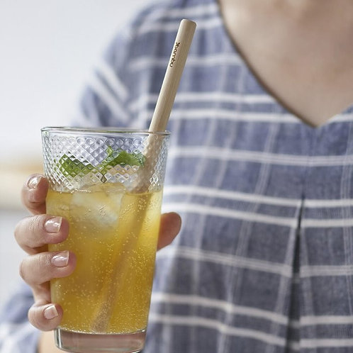 Bambu Precision Reusable Bamboo Straws in glass of juice being held