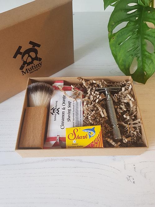 Mutiny safety razor kit, cinnamon orange soap, vegan shaving brush, replacement blades in box