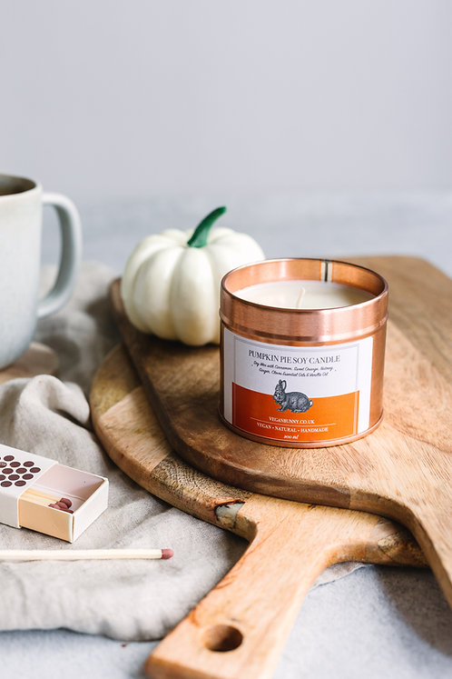 Vegan bunny Pumpkin Pie soy candle in amber tin with pumpkin