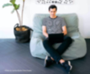 man-sitting-cozy-while-working-on-his-la