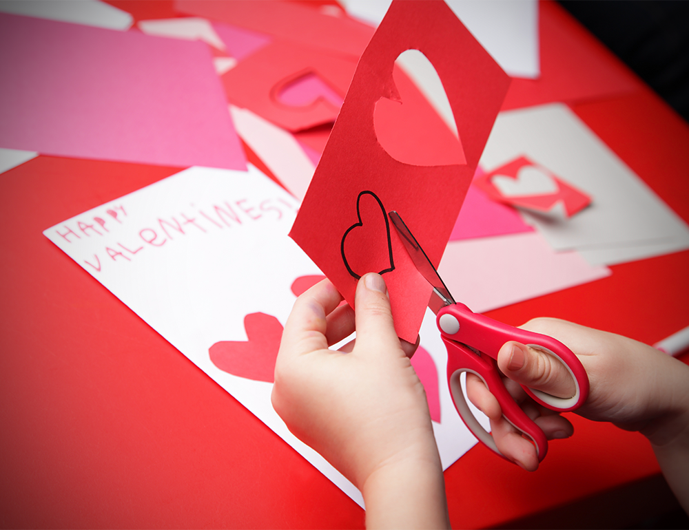 There's numerous ways to show your love and appreciation for those around you this month, starting with the holiday of hearts and chocolates: Valentine's Day. Valentine's cards are a tradition that kids love to embrace, with the excitement of exchanging cards with classmates (and the chocolate – don't forget the chocolate!). Making homemade cards is a great way for children to show their affection while practising their hand-eye coordination through cutting skills, gluing skills, and writing thoughtful messages.