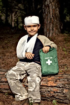 First Aid treatment given to a young boy