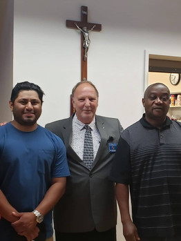 Meet Rolando (left) and Kofi (right), new members of the Knights of Columbus. Jim (Swanber