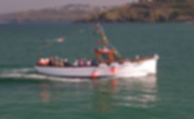 The Cornish Crest boat outside St Ives harbour with porthminster point in the background circa 2002