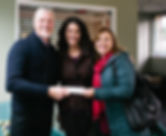 Accepting the generous donation from South Sound 100 woman!