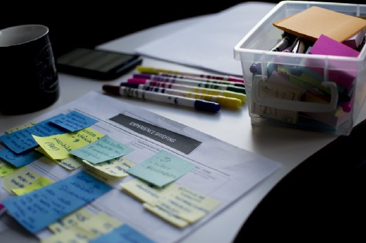 A calendar filled with post it notes.