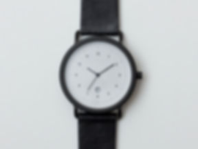 ESU watches, a three hand date watch in black with black bezel and attached with a black cowhide leather strap.