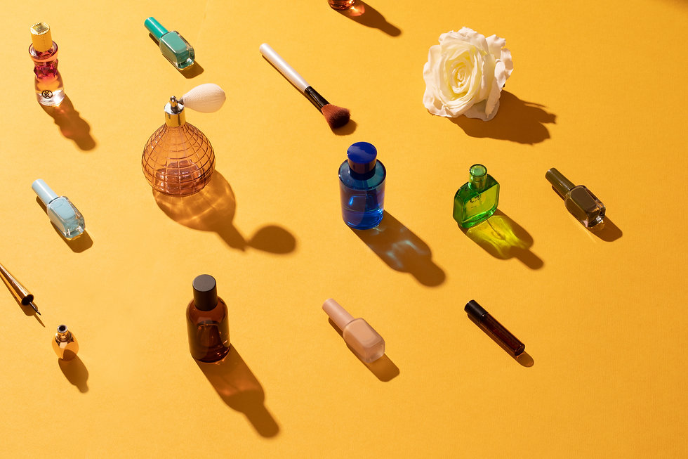 Composition of beauty products over yellow background
