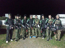 Group of friends playing a game of night paintball in Thessaloniki .