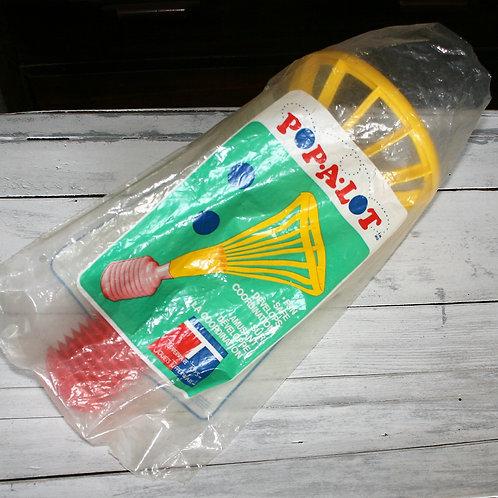 Tupperware Pop-A-Lot toy in original packaging