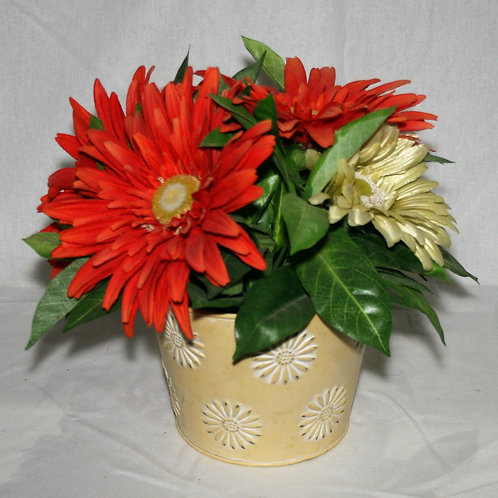 Yellow Metal Pot with Orange Flowers