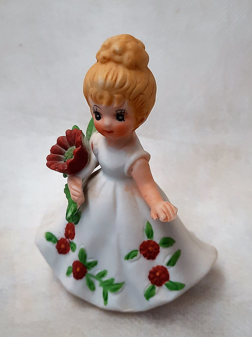 Small Girl with Red Flower Ornament