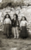 Lúcia Santos with her cousins Jacinta and Francisco Marto, 1917