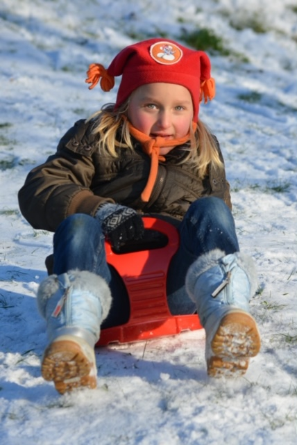 Sledding near the meadows brings smiles to children and adults alike!