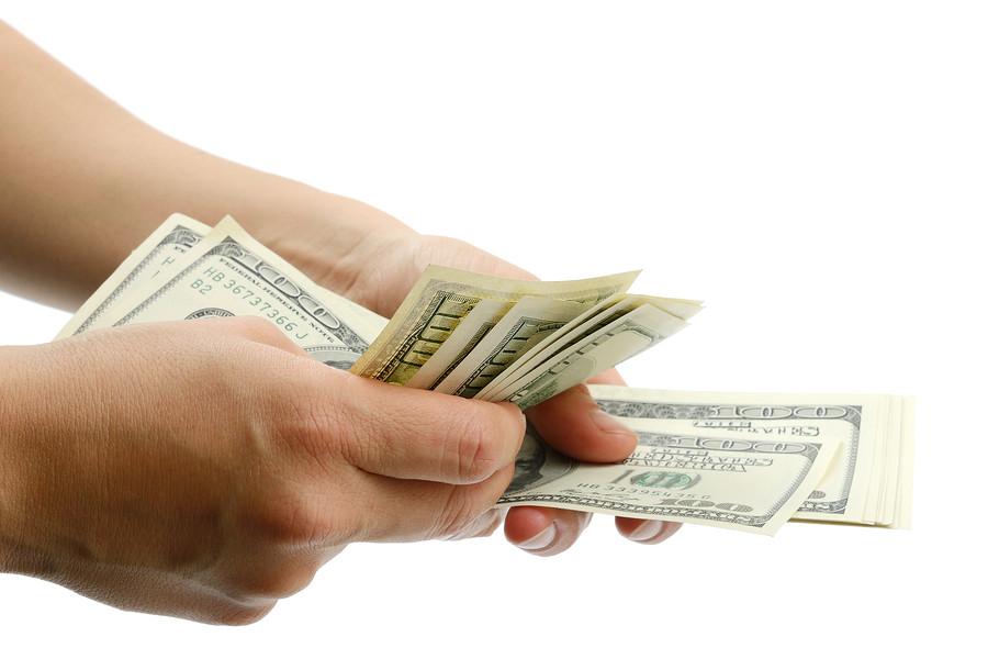 bigstock-Woman-Hand-With---Dollar-Bil-53380324.jpg