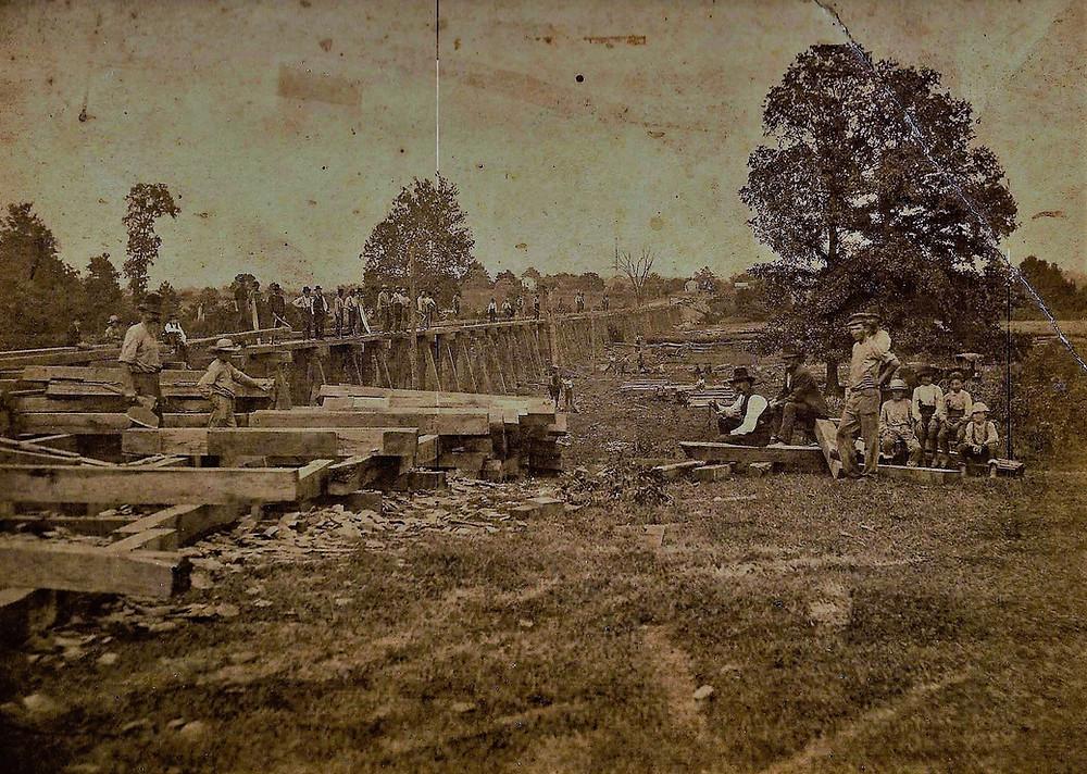 Men building the railroad through Baltimore and Basil