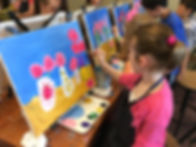 Child painting on canvas at Sipping N' Painting Hampden