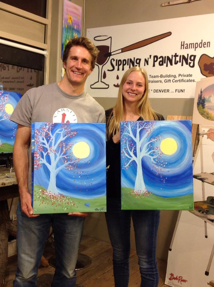 Couple on date night holiding their sip and paint paintings