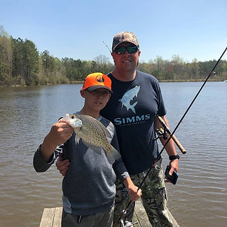 Boy and Dad with fish.jpg