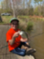 Handicapped Boy with fish 2.jpg