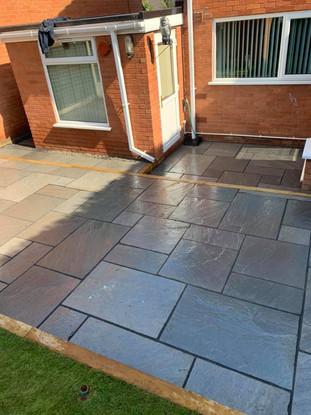 Grey slate patio in hagley