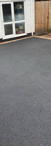 Paved edge and concrete driveway in