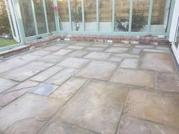 Naturasl sandstone slabs in conservatory in hagley