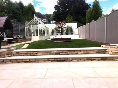 Paved patio in natural sandstone in romsley