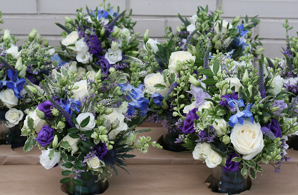 Delphinium, rose and thistle bridesmaids bouquets