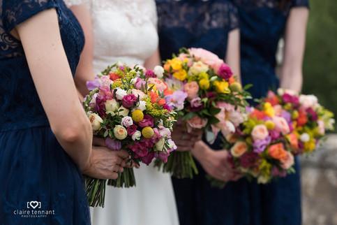 Oxenfoord Castle - Vibrant bridesmaids bouquets