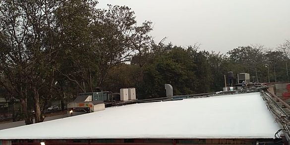 Sloping Roof Insulation after 2 coats of heat reflective paint.j