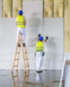 Men-putting-up-drywall.jpg