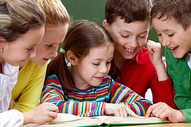 students-having-good-time-while-reading-