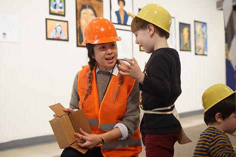 Teaching a recycled material installation class at the Brooklyn Museum
